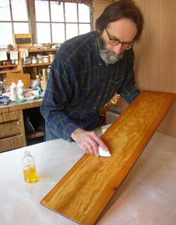 photo of Gary Wood applying wood finish