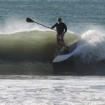 Carl Mahlstedt surfing on a stand up paddleboard