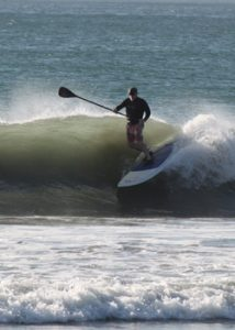 Carl Mahlstedt, owner of Goosebay Lumber, riding a Stand Up Paddleboard