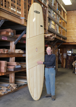 Carl Mahlstedt posed with his wooden SUP