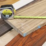 Phote of Tape Measure on a variety of exotic woods