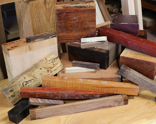 Photos of several sizes and species of turning squares, bowl blanks, and pen blanks.