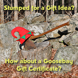 Photo of an ax in a stump with an elf hat and the words Stumped for a gift idea? How about a Goosebay Gift Certificate?