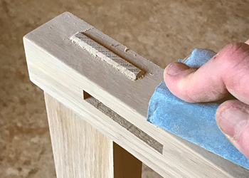 Photo of sanding a carftsman style joint.